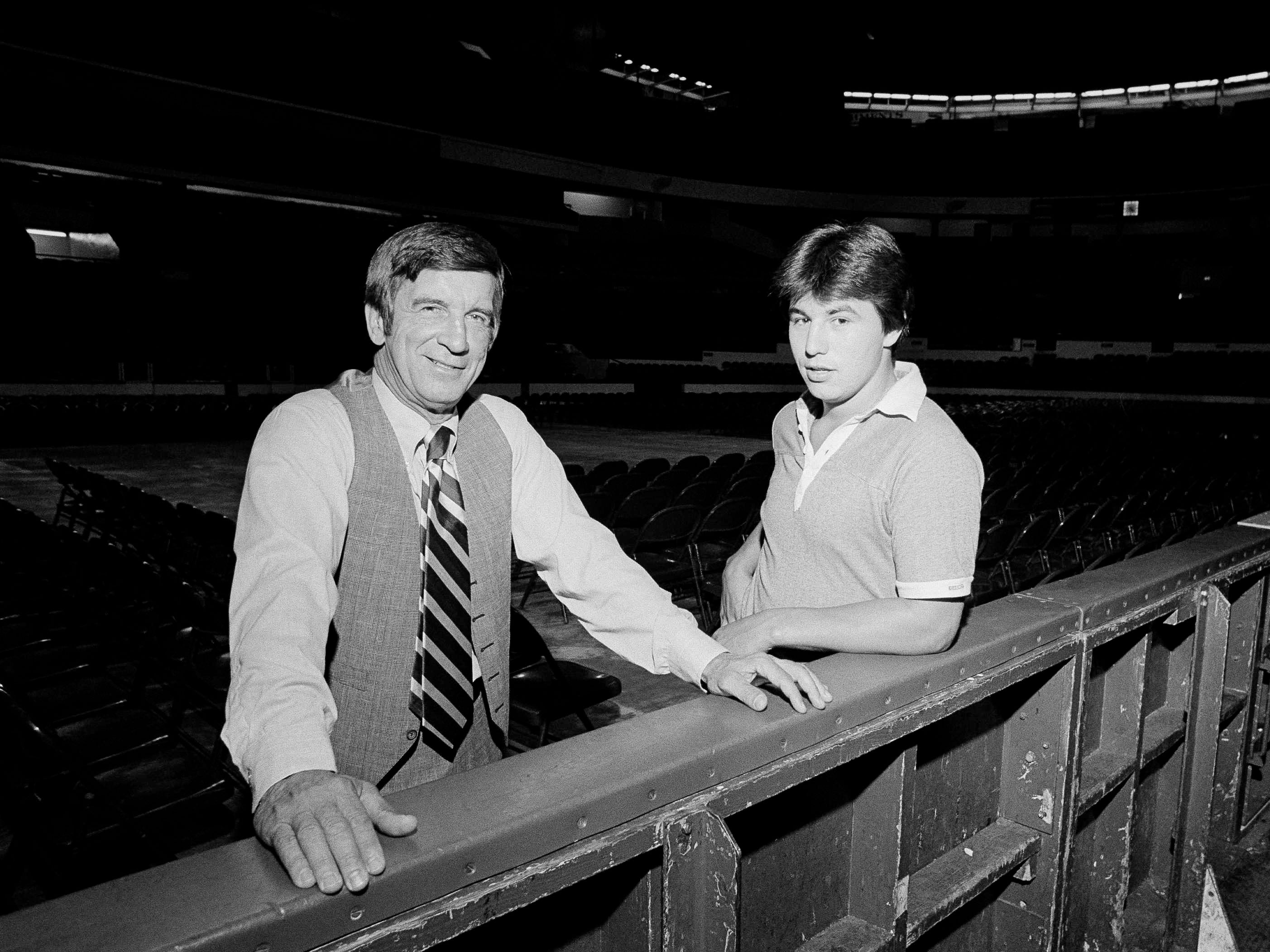 Red Wings general manager Ted Lindsay, left, and Wings center Dale McCourt on the edge of the rink in Olympia Stadium in Detroit, Sept. 20, 1978, before McCourt's departure to Wings training camp in Kalamazoo.