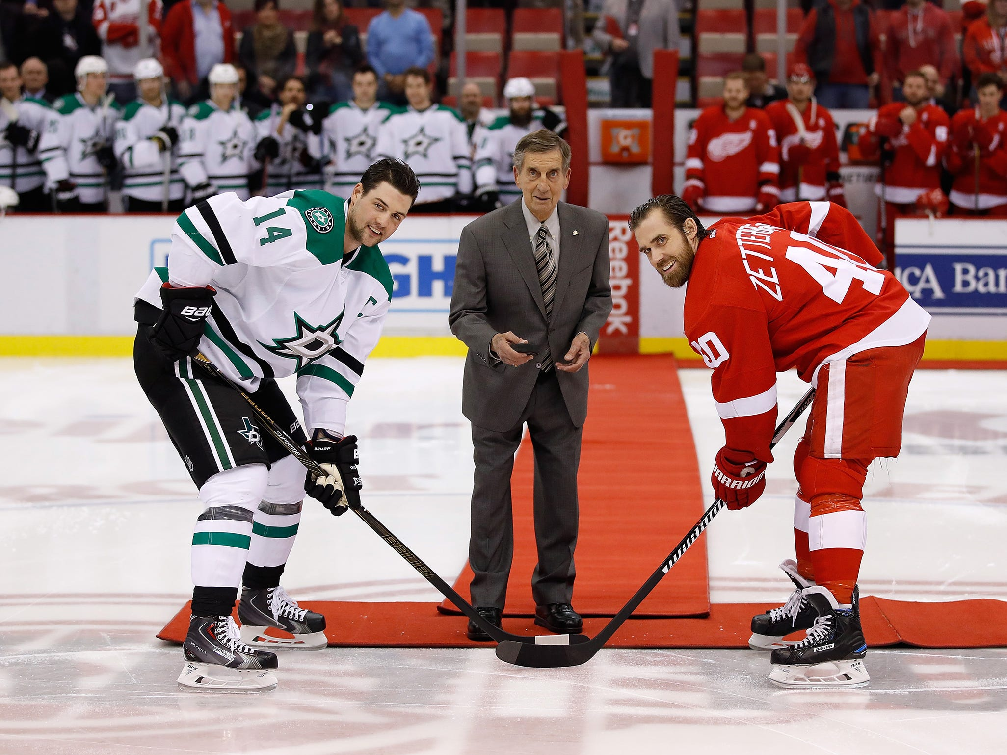 Red Wing Hall of Famer Ted Lindsay does a ceremonial puck drop between Jamie Benn of the Dallas Stars and Henrik Zetterberg of the Red Wings at Joe Louis Arena on November 29, 2016 in Detroit.