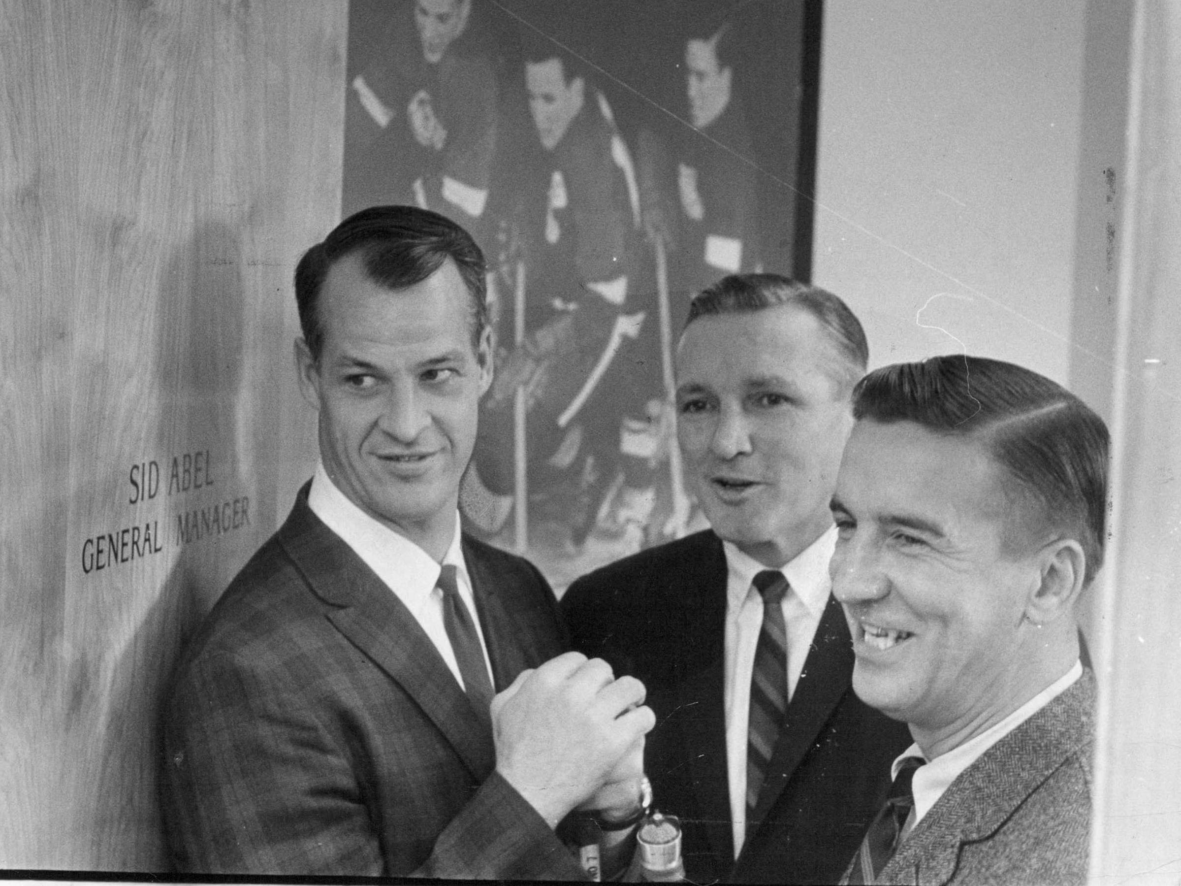 The production Line was reassembled on the eve of the Red Wing's NHL opener. Only one of the trio still is playing - Gordie Howe. Ted Lindsay, right, now a telecaster,  went up to Olympia to get a line on the Wings from Howe and general manager Sid Abel.