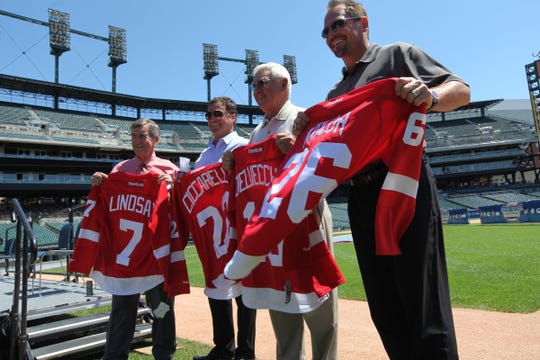 Former Red Wing players Ted Lindsay, Dino Ciccarelli, Alex Delvecchio and Joe Kocur show off their jerseys before the Winter Festival  Alumni Showdown game press conference  at Comerica Park in July 2012.
