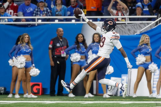 Chicago Bears safety Eddie Jackson (39) celebrates an interception from Detroit Lions quarterback Matthew Stafford (9) as he runs towards the end zone during the second half at the Ford Field in Detroit, Thursday, Nov. 22, 2018.