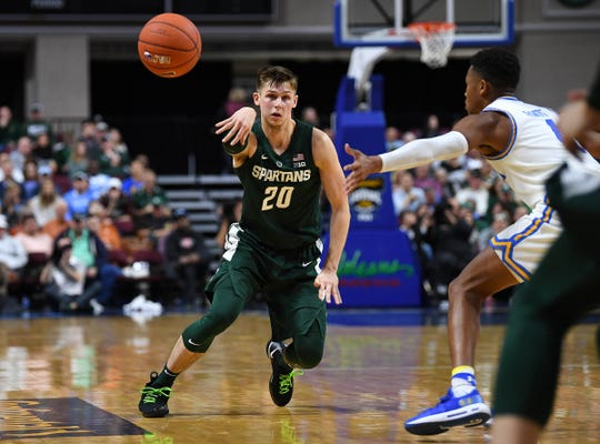 Michigan State Spartans guard Matt McQuaid (20) passes during the first half against the UCLA Bruins at Orleans Arena on Thursday, Nov. 22, 2018.