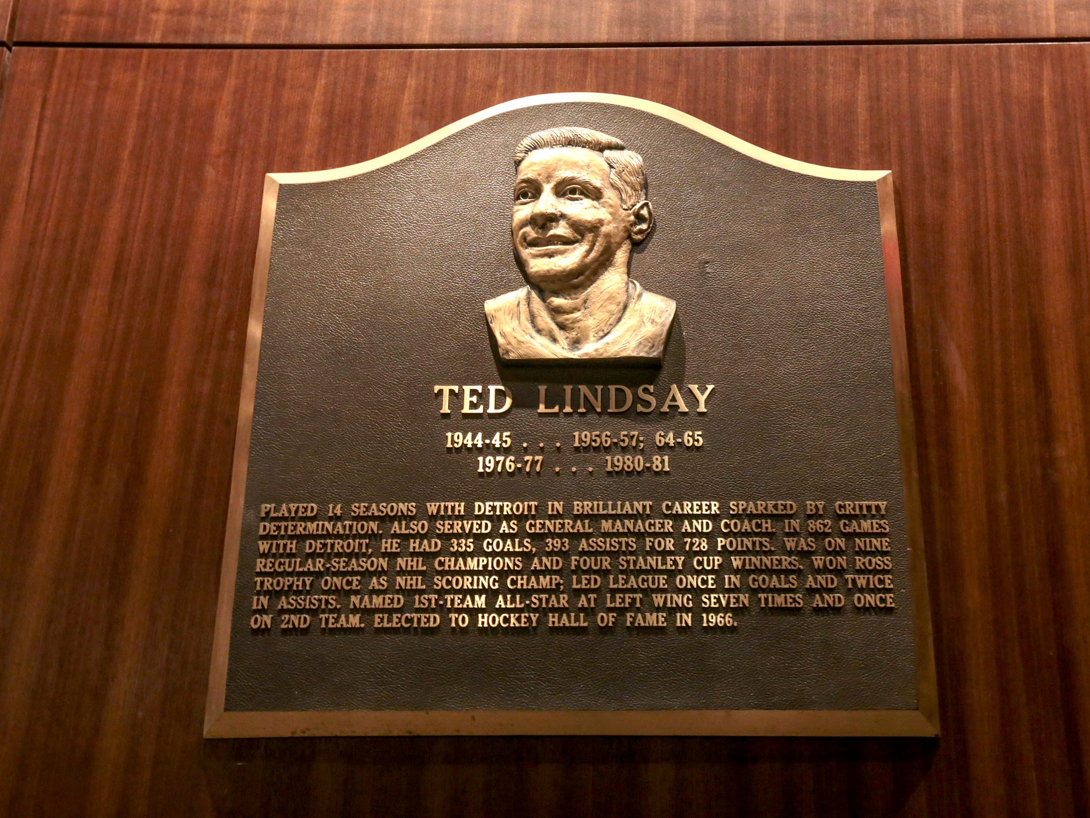 A plaque of former Detroit Red Wings player Ted Lindsay is seen hanging in a hallway off of the players lounge area during a media tour of the Little Caesars Arena in downtown Detroit in September 2017.