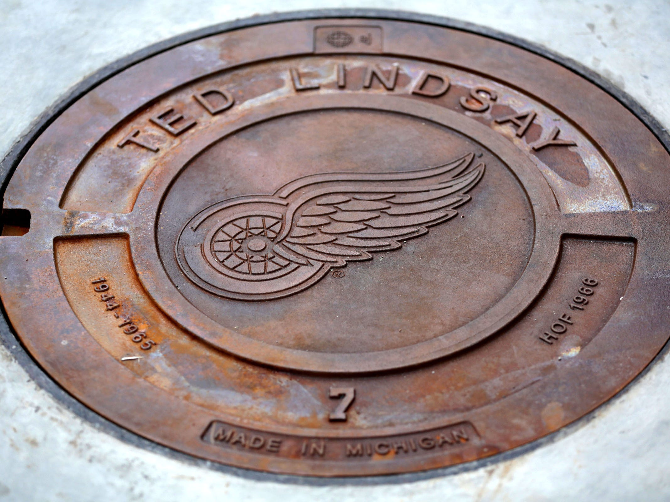 Manhole cover honoring Detroit Red Wings Ted Lindsay on the concourse level at Little Caesars Arena in Detroit on Wednesday, September 6, 2017.