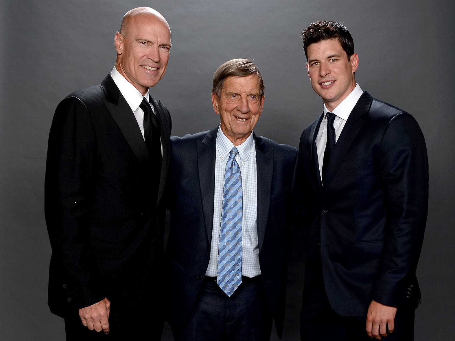 Former NHL Player Mark Messier, NHL Hall of Famer Ted Lindsay and Sidney Crosby of the Pittsburgh Penguins pose for a portrait during the 2014 NHL Awards at Encore Las Vegas on June 24, 2014 in Las Vegas.