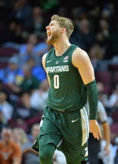 Michigan State's Kyle Ahrens celebrates after hitting a 3-pointer against UCLA during the 2018 Continental Tire Las Vegas Invitational basketball tournament at the Orleans Arena on Thursday, Nov. 22, 2018 in Las Vegas.