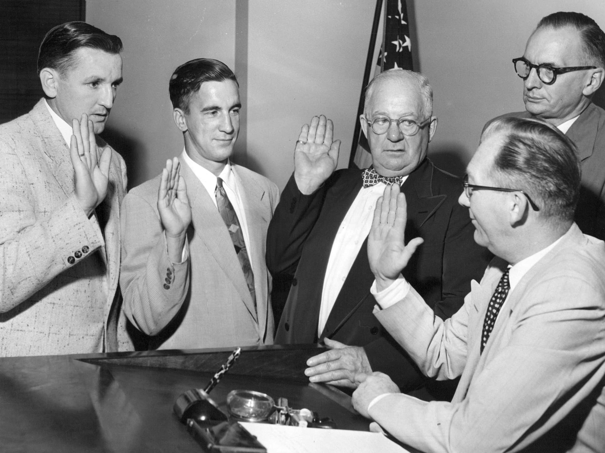 U.S. Citizen Ted Lindsay is sworn in after receiving final papers in Federal Court. Vouching for Ted in the ceremonies are from left Sid Abel,  Lindsay, Red Wings Manager Jack Adams and Chief of Naturalization Bernard Steen.