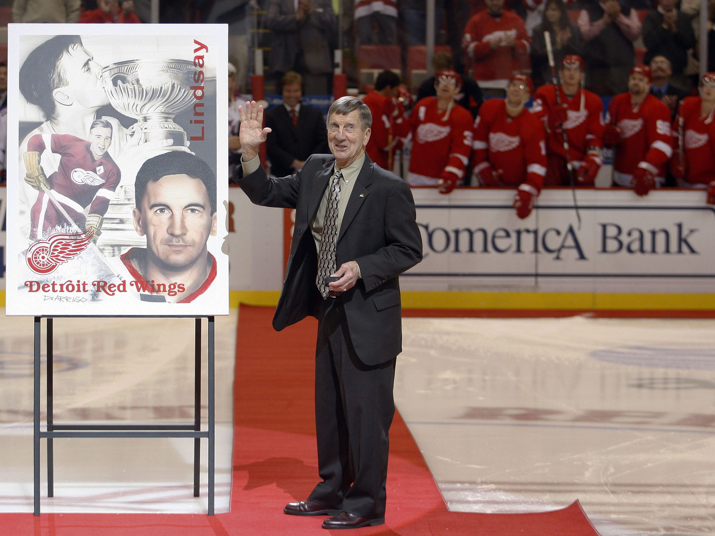 Red Wings legend Ted Lindsay waves to the crowd prior to start of game between the Red Wings and the New York Rangers on October 18, 2008 at the Joe Louis Arena in Detroit.