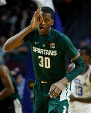 Michigan State's Marcus Bingham Jr. celebrates a 3-point basket against UCLA during the first half of an NCAA college basketball game Thursday, Nov. 22, 2018, in Las Vegas.