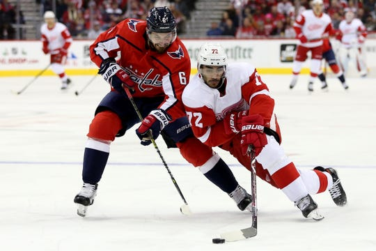 The Capitals' Michal Kempny and Red Wings forward Andreas Athanasiou go after the puck during the first period on Friday, Nov. 23, 2018, in Washington.