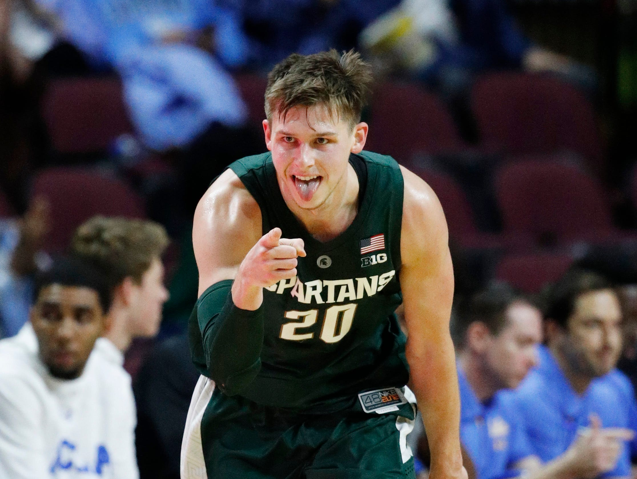 Michigan State's Matt McQuaid celebrates after scoring against UCLA during the first half of an NCAA college basketball game Thursday, Nov. 22, 2018, in Las Vegas.
