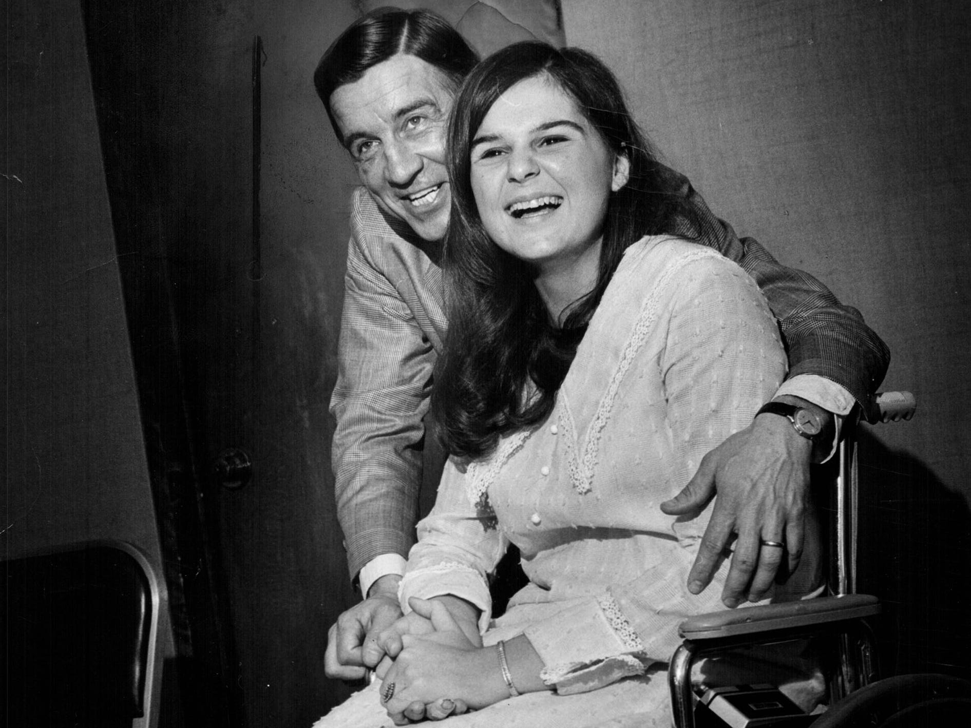 Ted Lindsay, former Red Wing hockey great, and Darleae Kaminski, a gold medal winner at the Paralympics Games in 1969..