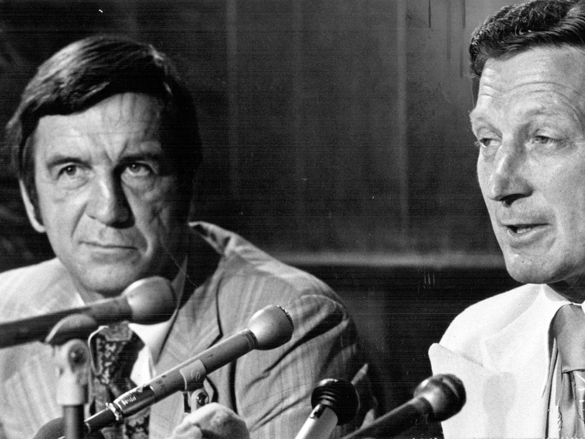In June 19777, Detroit Red Wings General Manager Ted Lindsay, left, listens as Bobby Kromm, coach of the WHA Winnipeg Jets for the past two seasons, responds to questions at a press conference in Detroit.  Kromm was named as the new coach of the Red Wings by Lindsay.