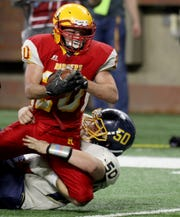 Reading #20 Ethan LoPresto gets tackled by Brekenridge #50 Corbin Reed during first half the division 8 MHSAA football finals between Breckenridge and Reading at Ford Field in Detroit on Friday November 23, 2018.Reading won the game 39-20 to win their first ever state football title.