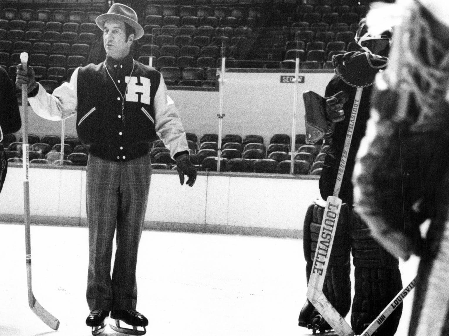Ted Lindsay explains strategy at Hillsdale College practice in 1976