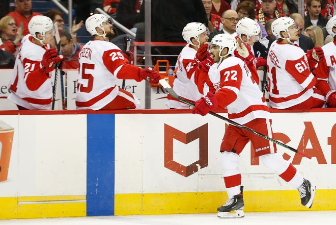 Nov 23, 2018; Washington, DC, USA; Detroit Red Wings center Andreas Athanasiou (72) celebrates with teammates after scoring a goal against the Washington Capitals in the first period at Capital One Arena. Mandatory Credit: Geoff Burke-USA TODAY Sports