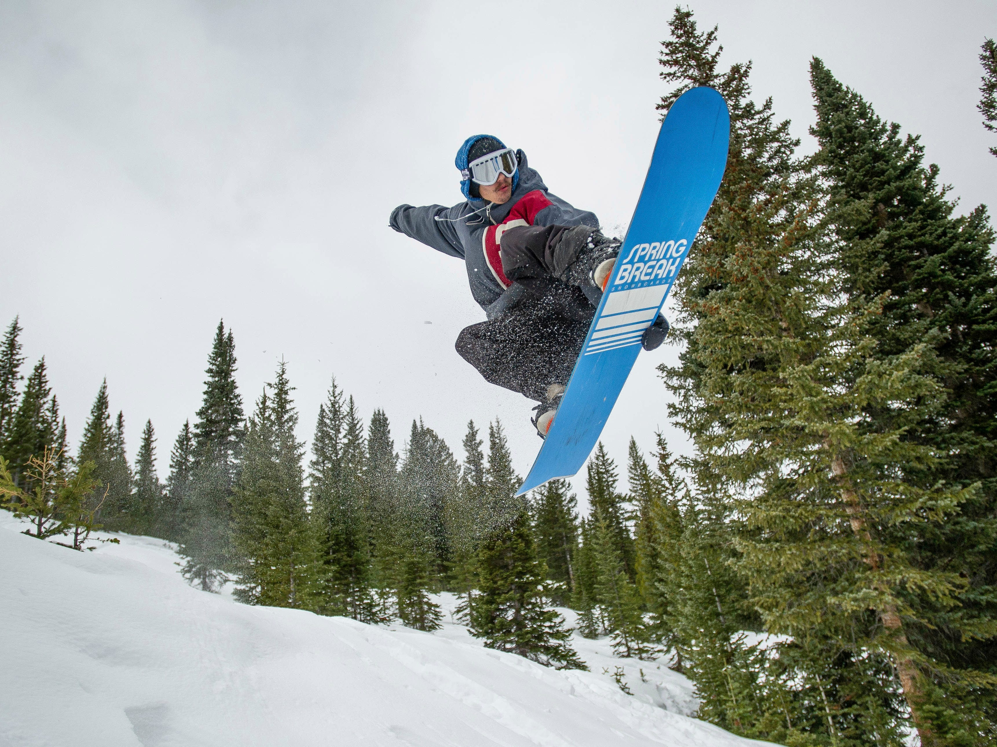 Josh Stump snowboards down Snowmass Mountain in Colorado, Friday, Nov. 23, 2018. Snowmass Ski Area, Crested Butte Mountain Resort and Telluride Ski Resort all opened for the season Thursday.