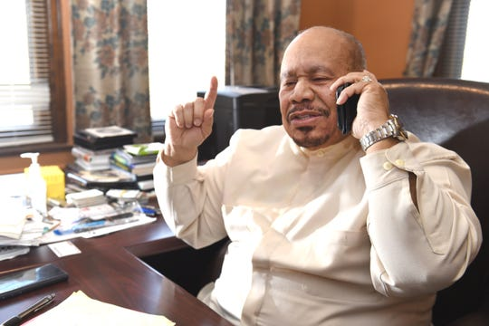 Bishop Lewis Evans, senior pastor at Soul Harvest Ministries, reaches out to the community on a radio program in an effort  to raise thousands of dollars to fully renovate the church and gymnasium.  He's seen in his church offices in Highland Park.
