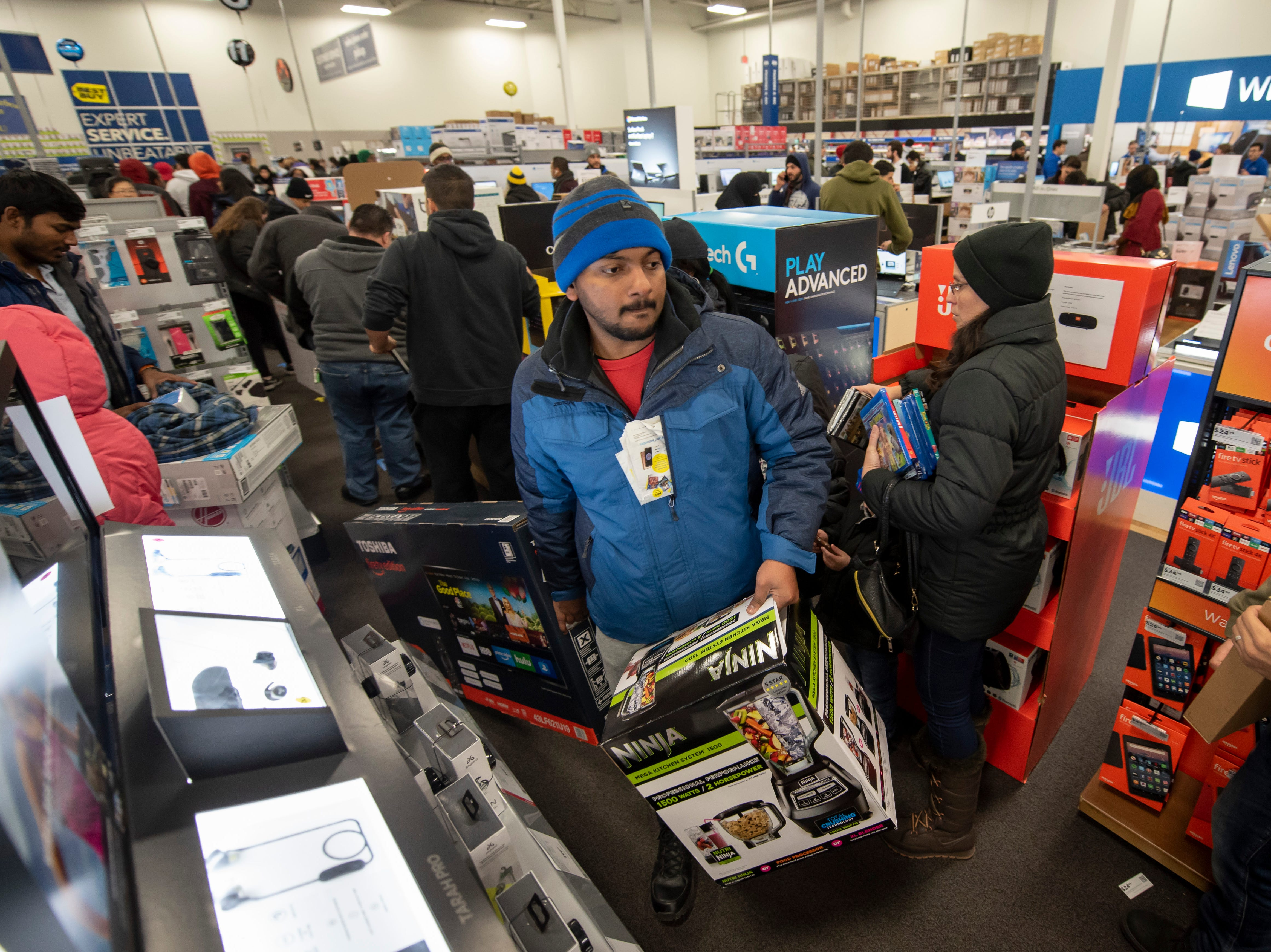 Shoppers look for merchandise during a Thanksgiving evening sale.