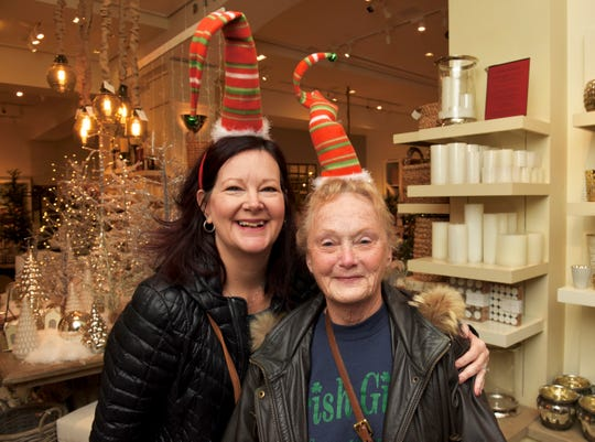 Stefanie Ellis, left, of Garden City,  and her mother Sharon Ellis wear matching hats so they can find each other in the Black Friday crowd at Twelve Oaks Mall in Novi on Friday.