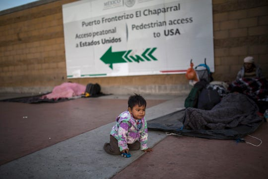 Steven Aguila, 2, from El Salvador, plays with a toy car at the Chaparral border crossing, in Tijuana, Mexico, Friday, Nov. 23, 2018.