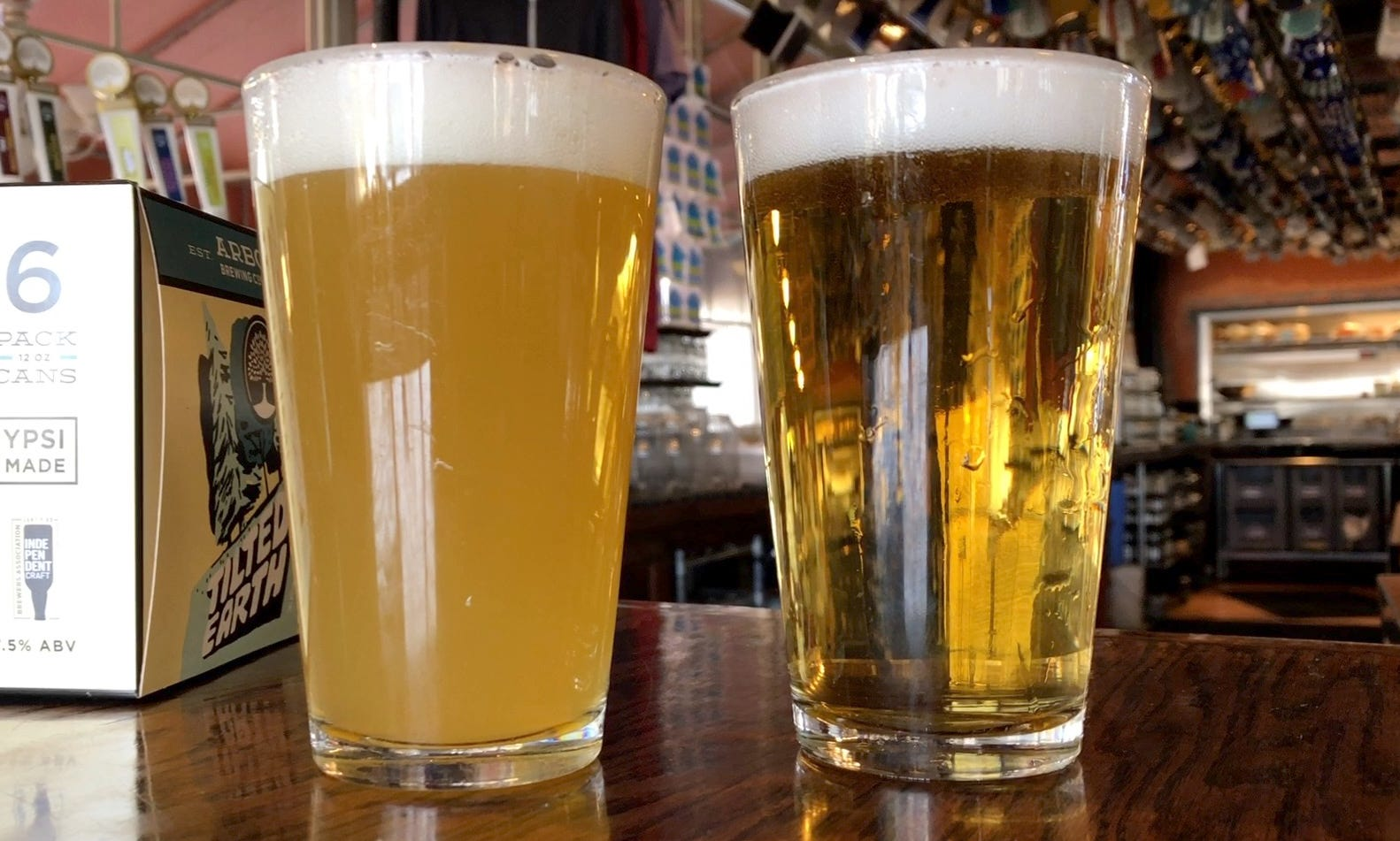 "Arbor Brewing's new ""Tilted Earth Winter IPA,"" a New England styled IPA is on the left. On the right is their just-released brut ipa ""Good & Proper."""