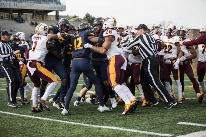 The Central Michigan and Toledo football teams brawl Friday.