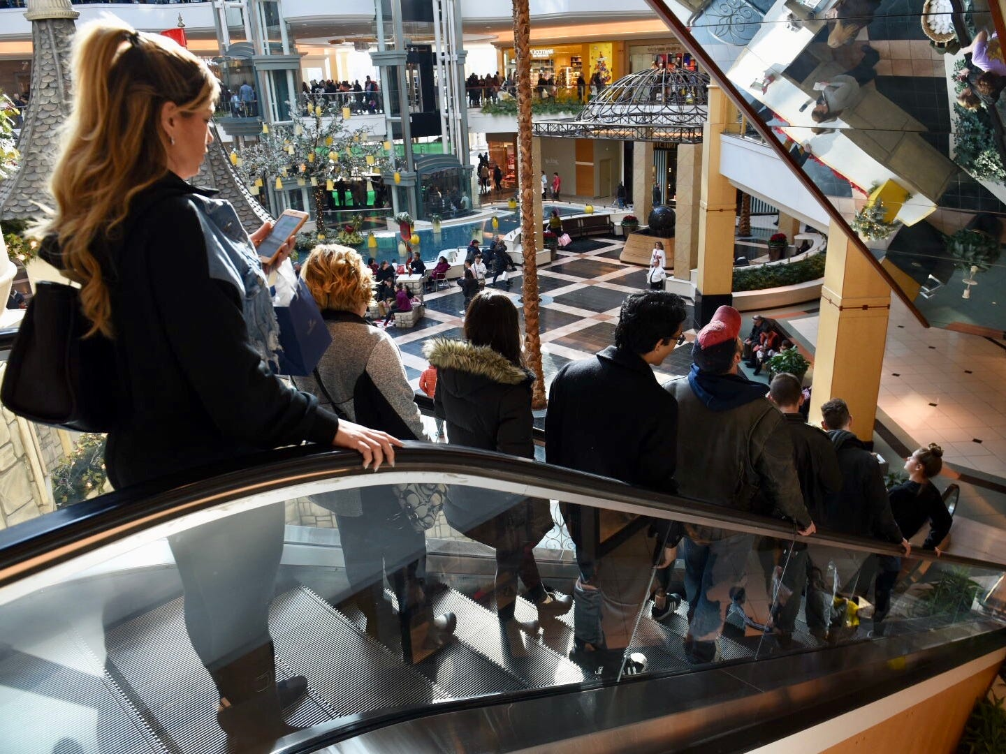 People pack an escalator at the Somerset Collection in Troy for Black Friday shopping .