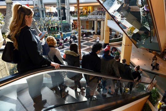 People pack an escalator at the Somerset Collection in Troy for Black Friday shopping.