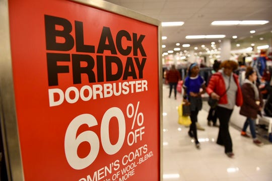 Shoppers crowd Macy's department store at Twelve Oaks Mall in Novi for their doorbuster sales on Friday, Nov. 23, 2018.