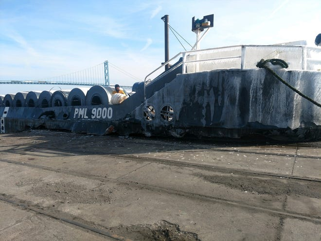 Canadian barge hits the edge of Nicholson Pier in Detroit River Friday morning.