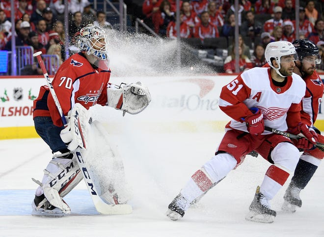 Washington Capitals goaltender Braden Holtby (70) stands as the ice sprays in front of him next to Detroit Red Wings center Frans Nielsen (51) during the second period.