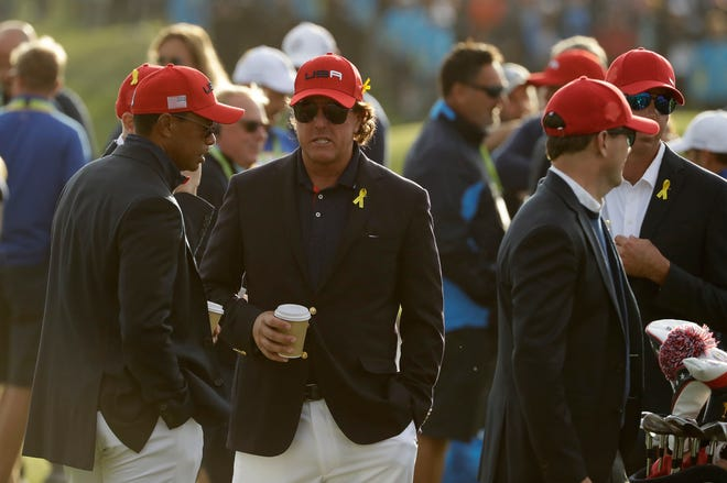 Tiger Woods, left, and Phil Mickelson will go head-to-head in a $9 million match Friday in Las Vegas.