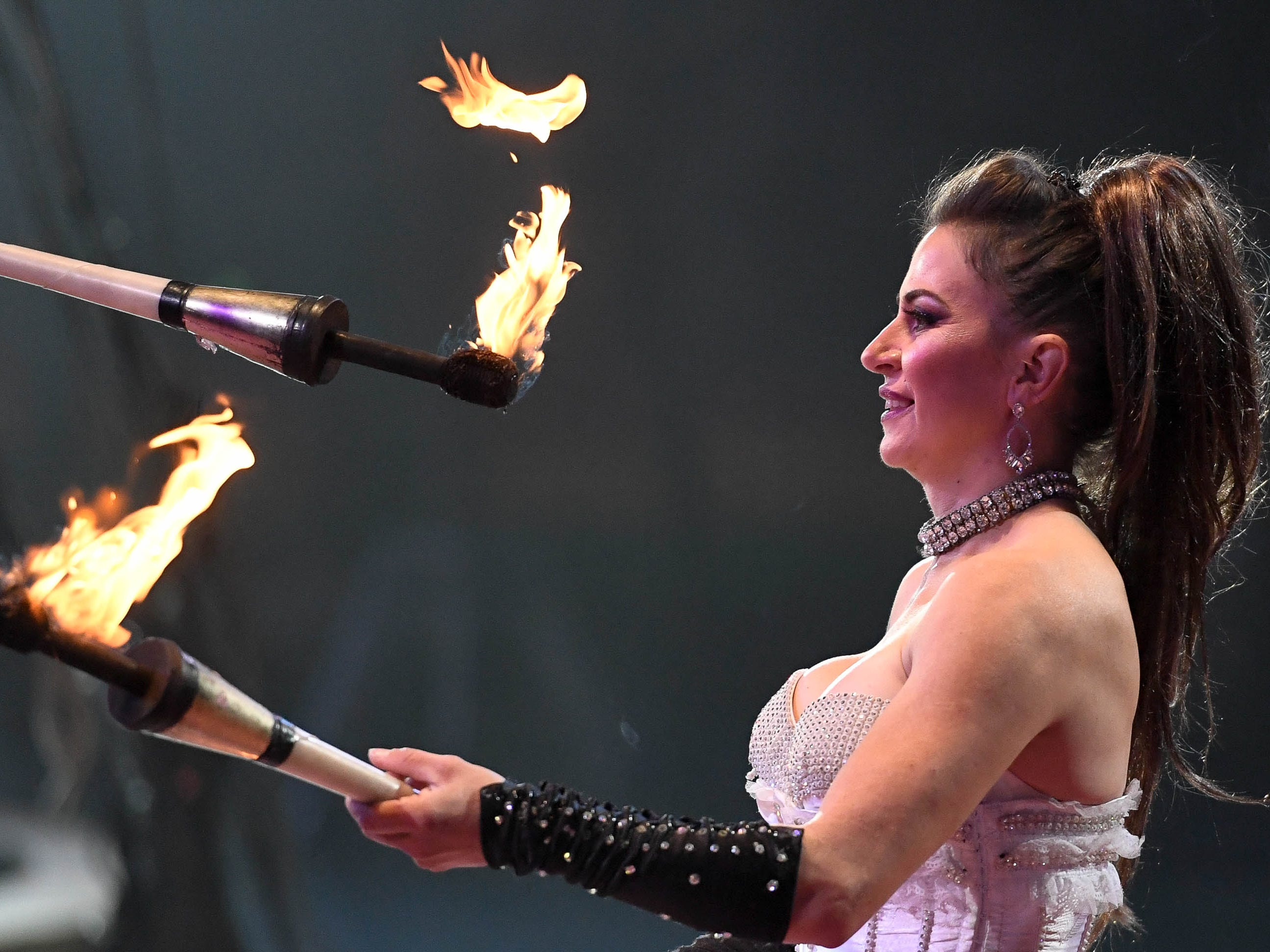 Mychelle Omar displays her juggling skills with flaming torches during the 85th annual Hadi Shrine Circus at the Evansville Ford Center Friday, November 23, 2018.