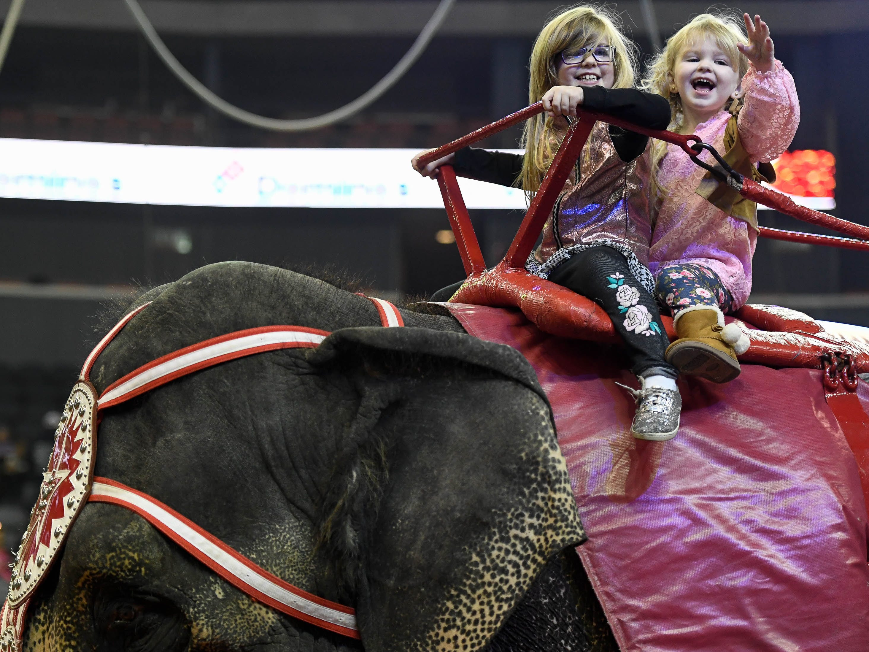Sisters Emma, six years-old, and Chloe, four years-old,  Loehrlein get a chance to ride a elephant at the 85th annual Hadi Shrine Circus at the Evansville Ford Center Friday, November 23, 2018.