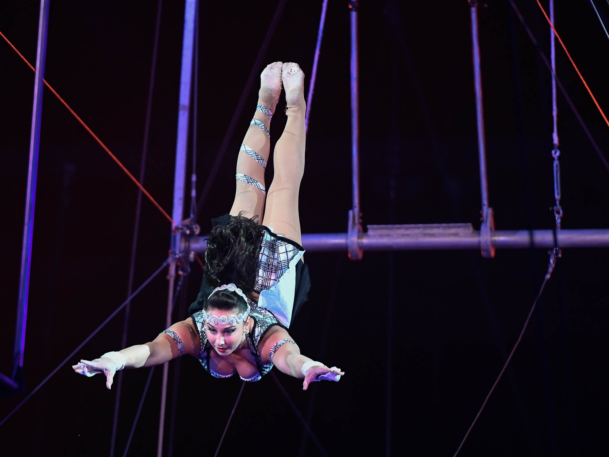 A member of The Flying Cortez performs during the 85th annual Hadi Shrine Circus at the Evansville Ford Center Friday, November 23, 2018.