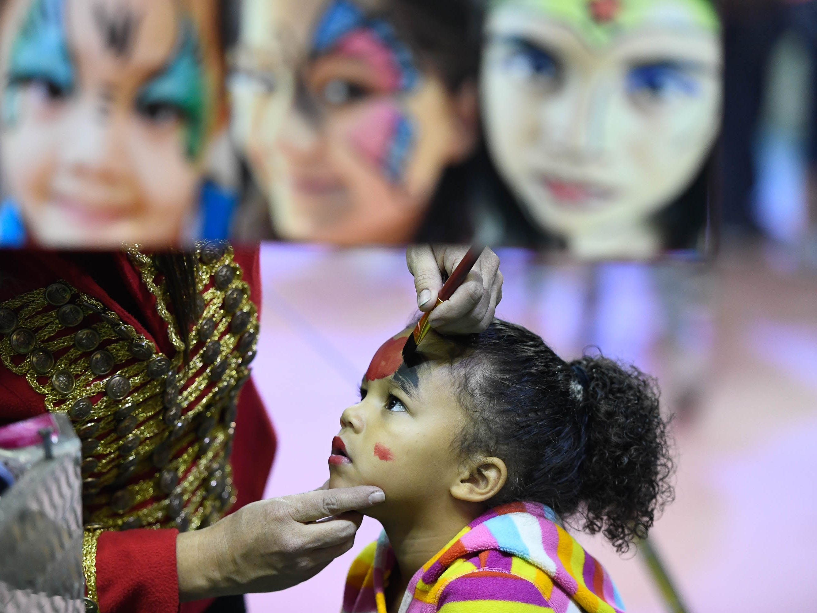Bree Floyd, three years-old, gets her face painted during intermission at the 85th annual Hadi Shrine Circus at the Evansville Ford Center Friday, November 23, 2018.