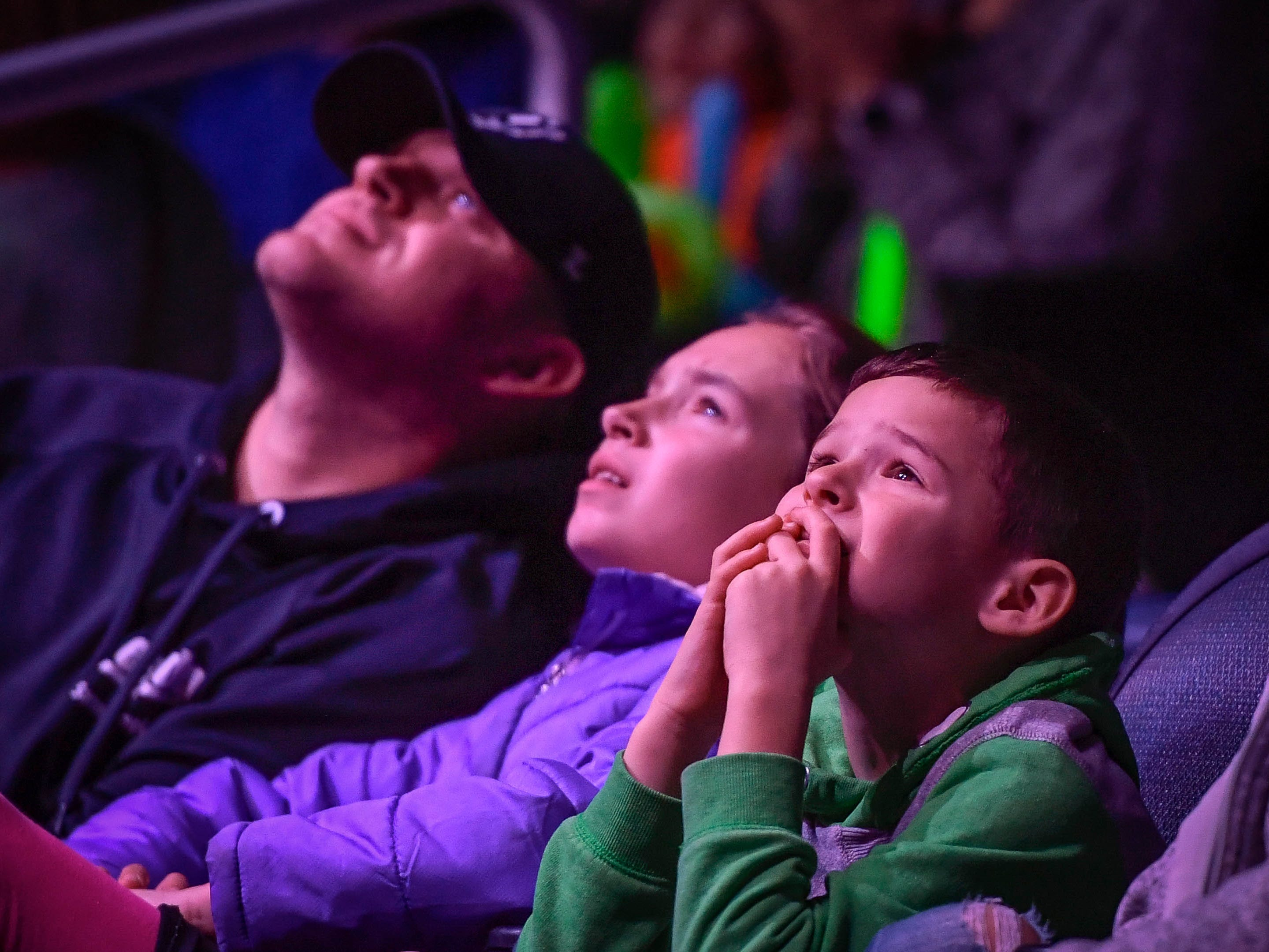 Brayden Eskew, right, seven years-old, can't stand the suspense as he watches a aerial act with his father Derek and sister Breah Eskew, 11 years-old, during the 85th annual Hadi Shrine Circus at the Evansville Ford Center Friday, November 23, 2018.