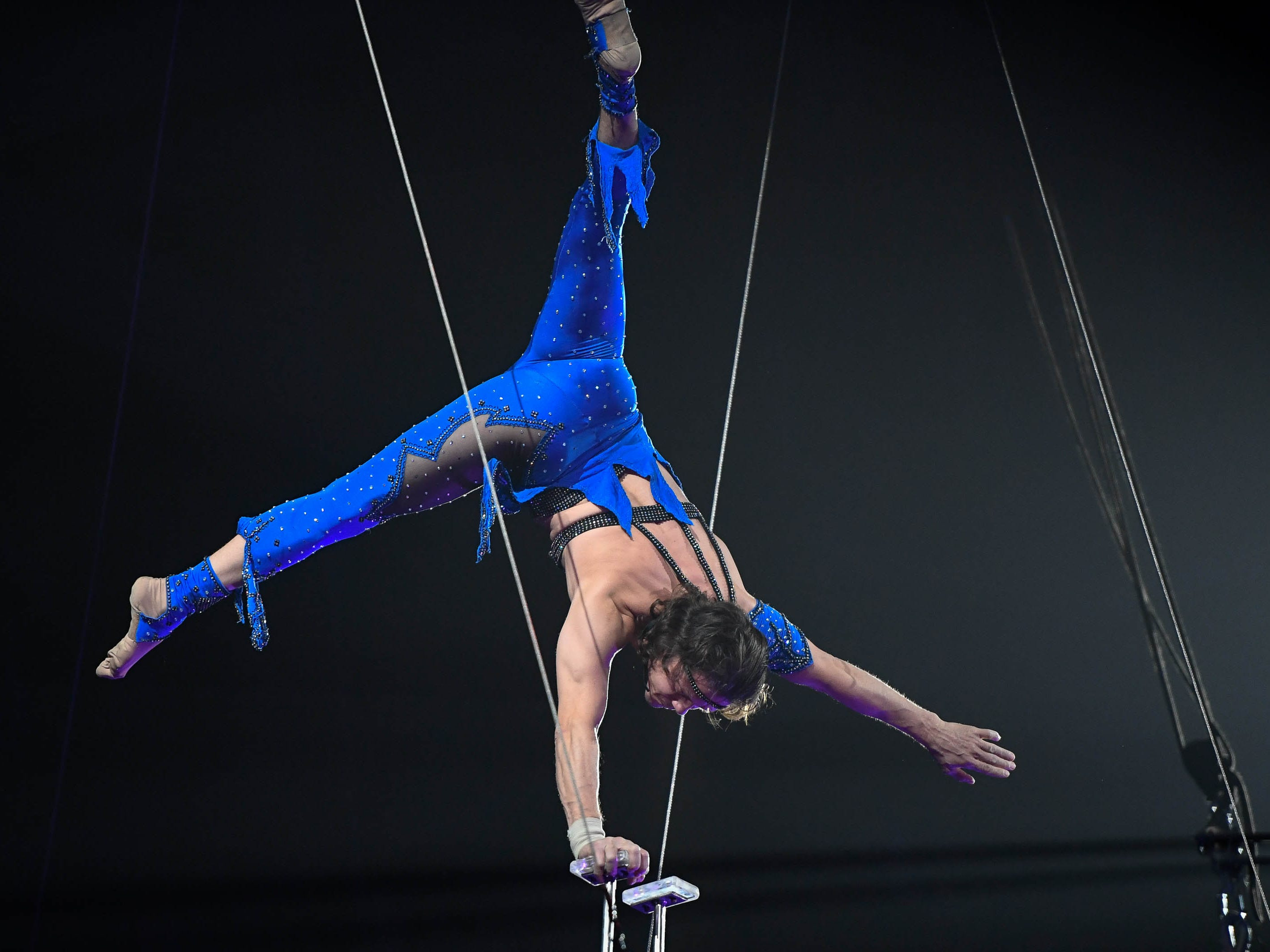 German Fassio preforms hand stands high the air at the Ford Center during the 85th annual Hadi Shrine Circus Friday, November 23, 2018.