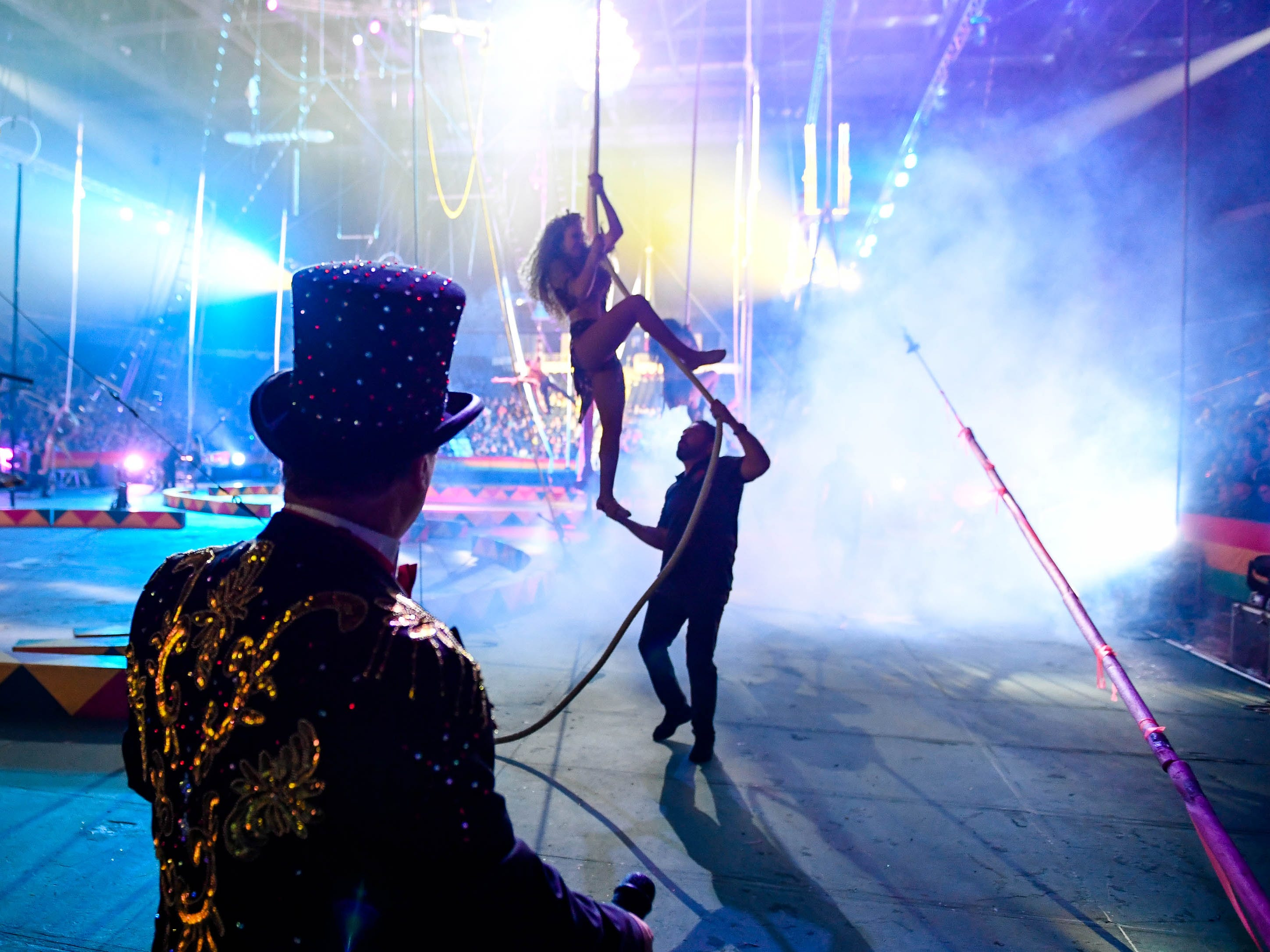 Ring Master Ari Steeples watches as aerialist dismount during the 85th annual Hadi Shrine Circus at the Evansville Ford Center Friday, November 23, 2018.