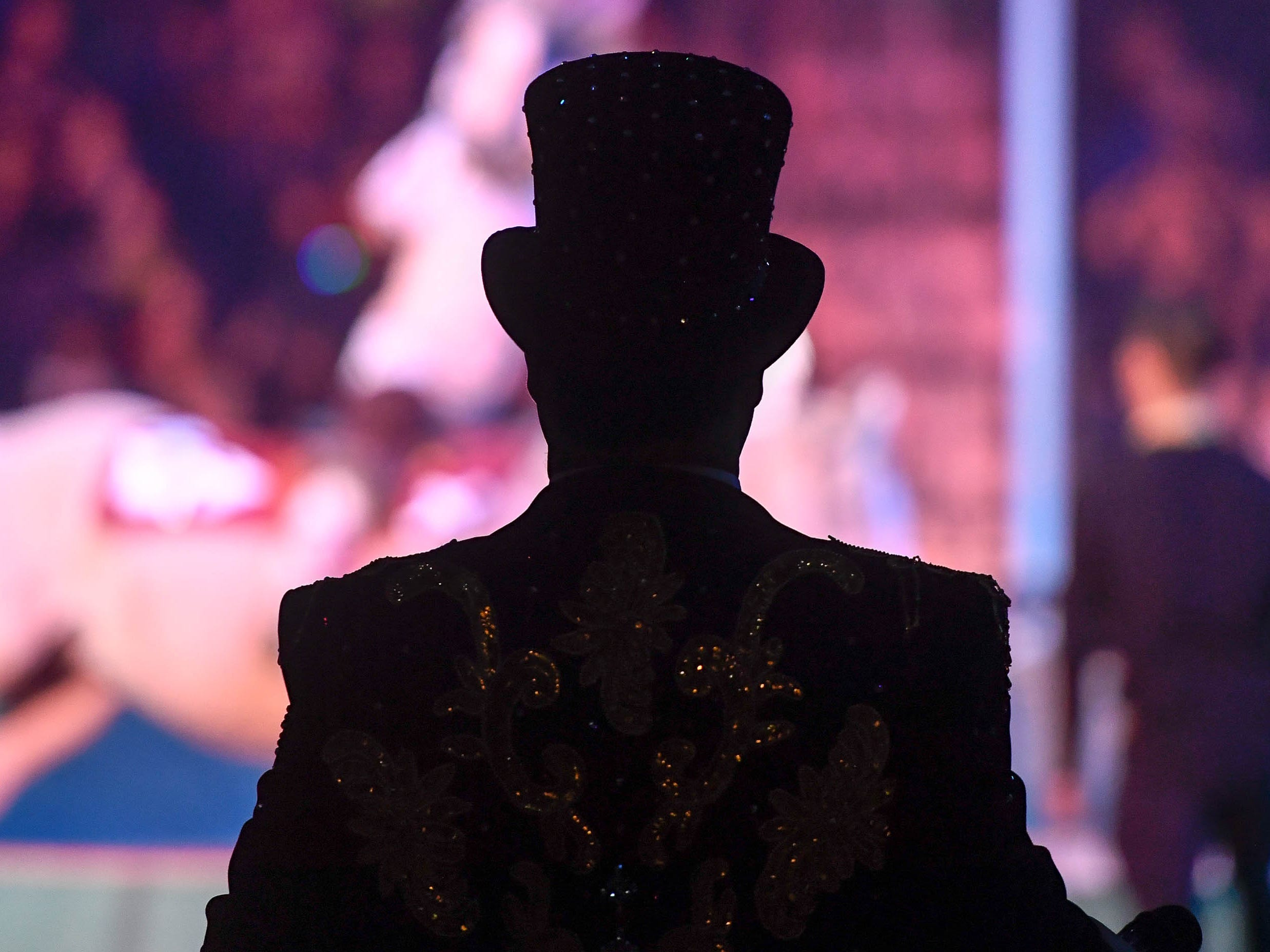 Ringmaster Ari Steeples watches the action during the 85th annual Hadi Shrine Circus at the Evansville Ford Center Friday, November 23, 2018.