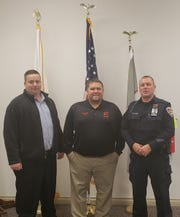 Gibsonburg Mayor Steve Fought with new police chief Dan Collins, right and assistant police chief Don Karr, left.