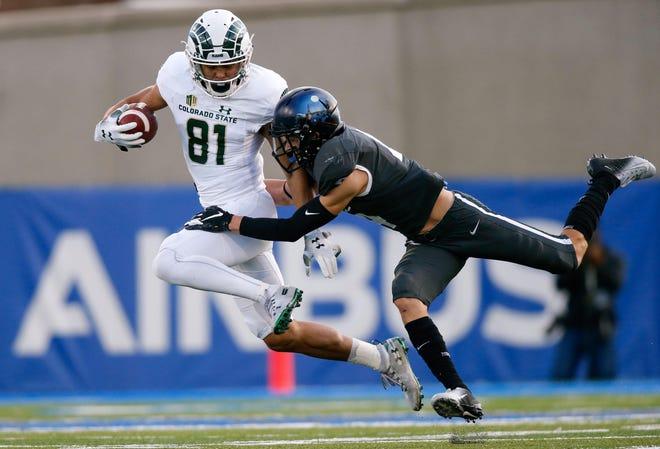 Nov 22, 2018; Colorado Springs, CO, USA; Air Force Falcons defensive back Milton Bugg III (4) tackles Colorado State Rams wide receiver Olabisi Johnson (81) after a reception in the third quarter at Falcon Stadium.