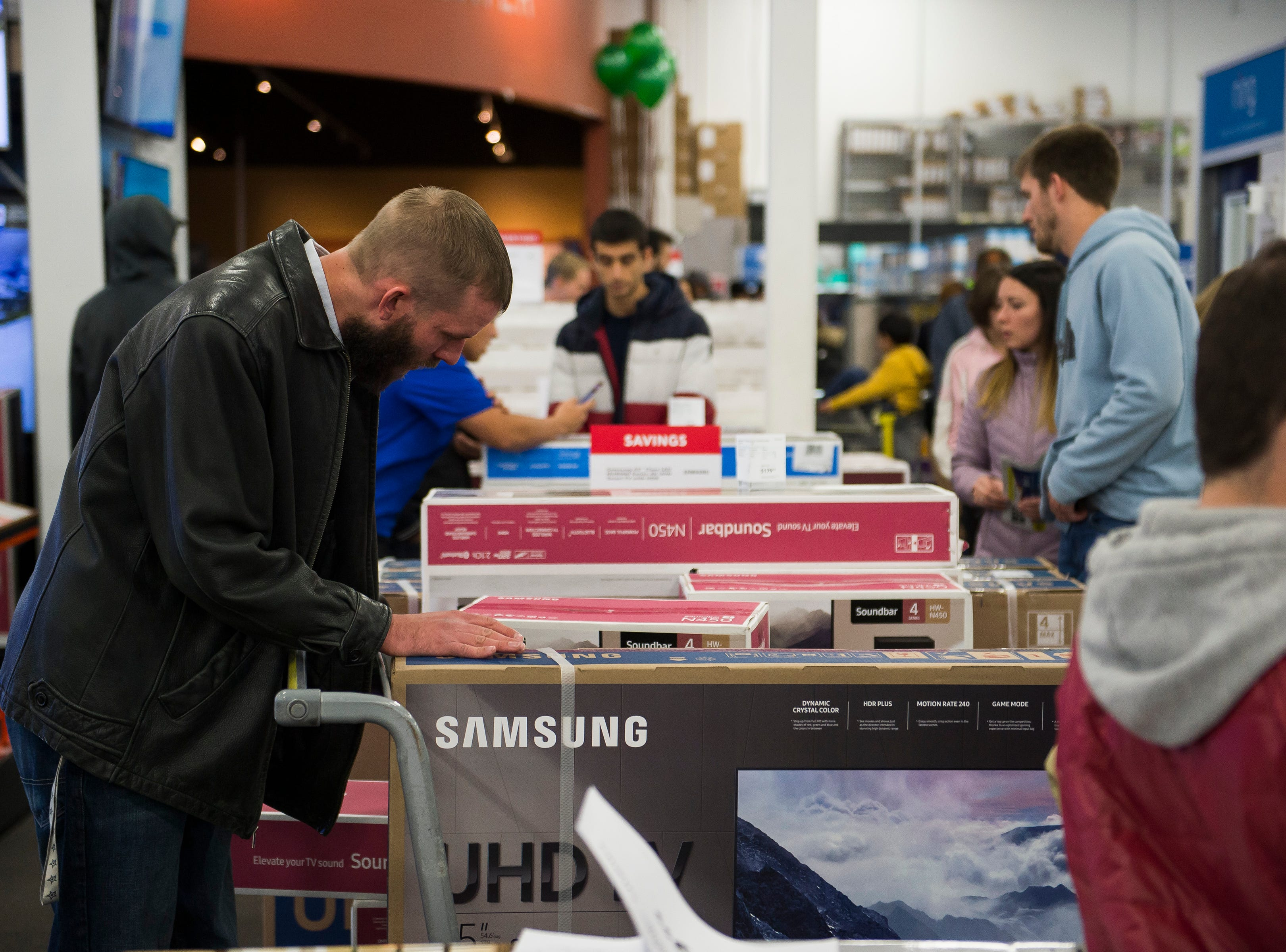 Customers browse through displays on Thursday, Nov. 22, 2018, at Best Buy in Fort Collins, Colo.