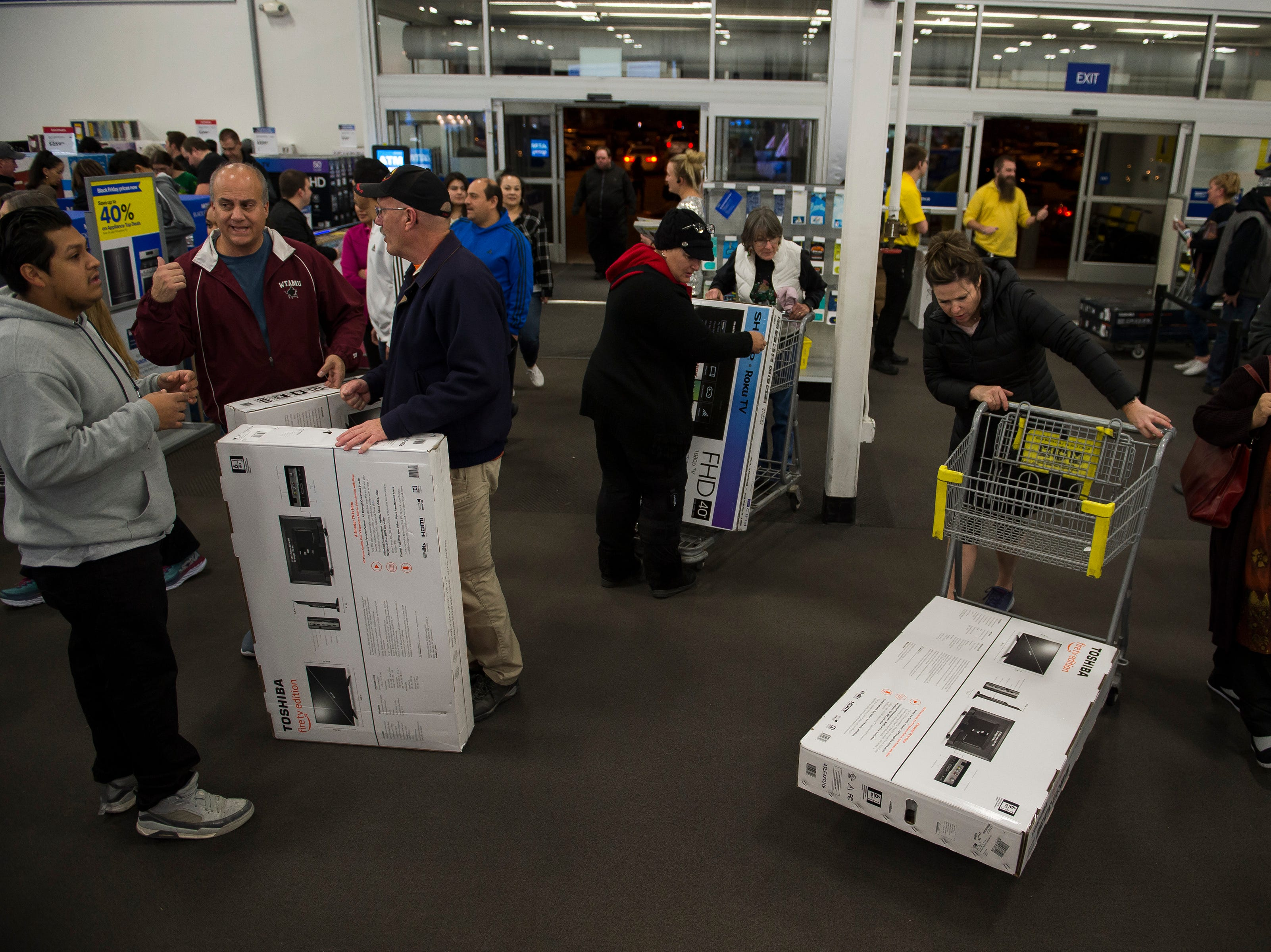 Customers look for deals on Thursday, Nov. 22, 2018, at Best Buy in Fort Collins, Colo.