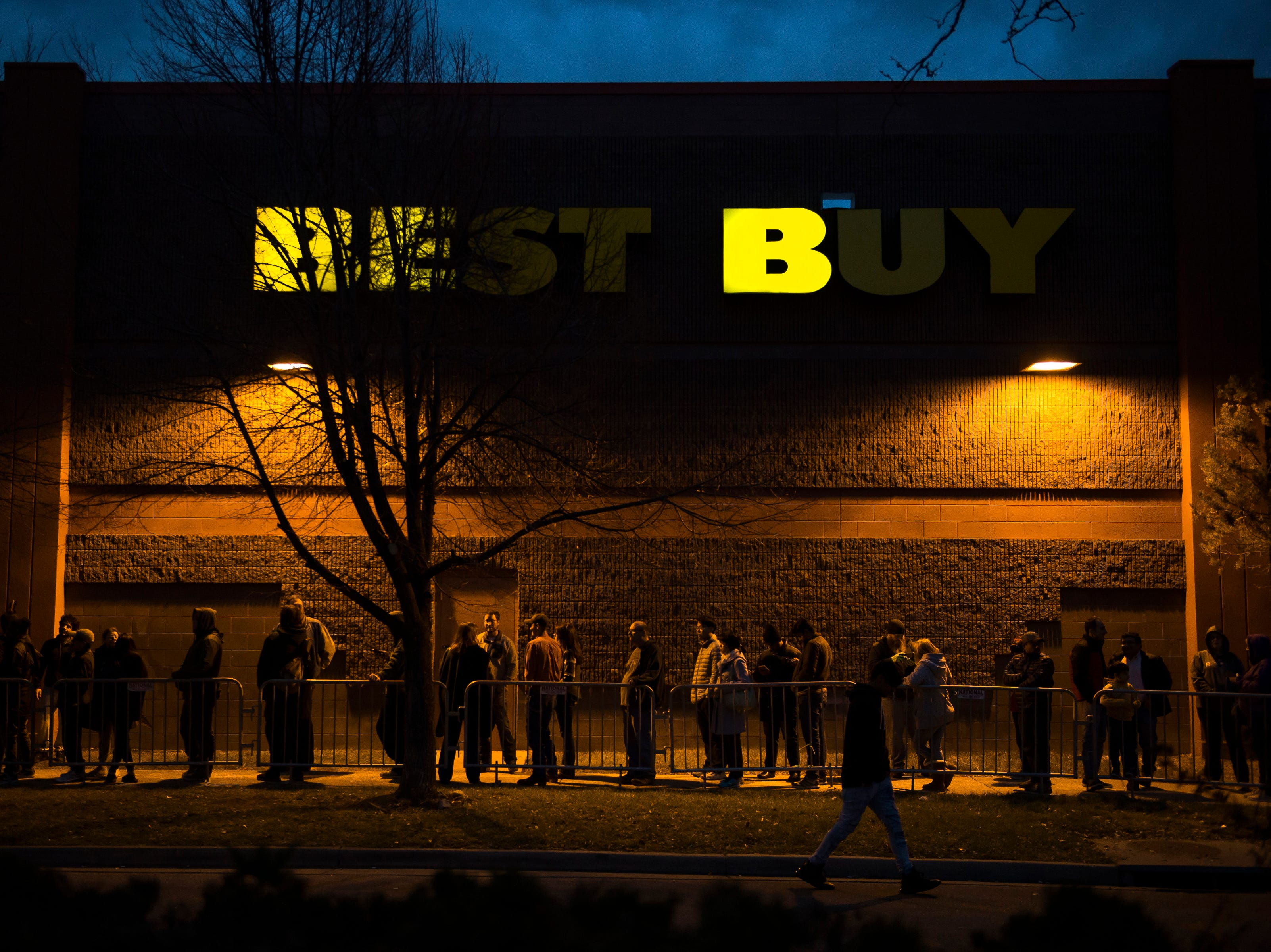 Customers line up outside waiting for the doors to open on Thursday, Nov. 22, 2018, at Best Buy in Fort Collins, Colo.