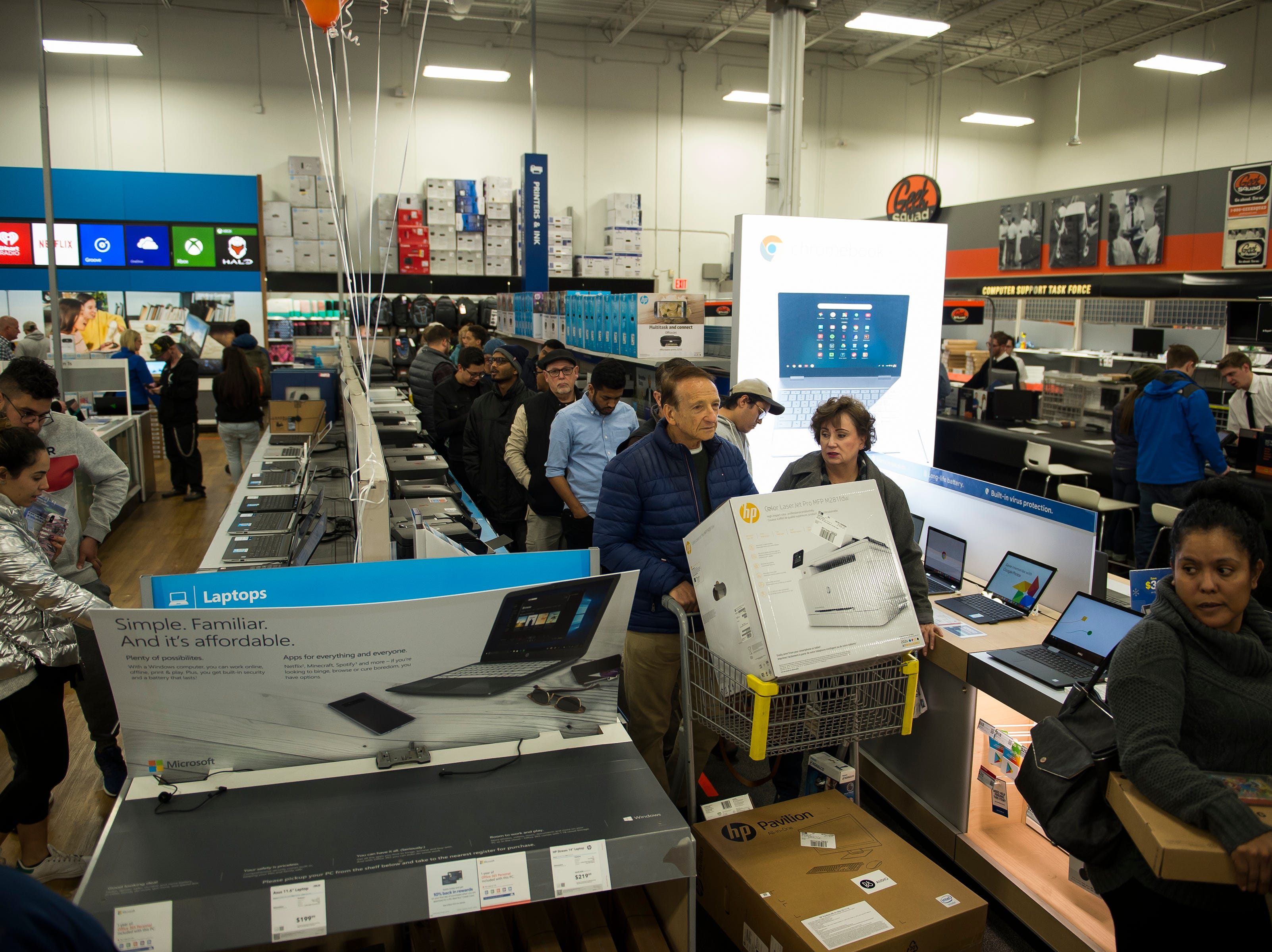 A line of customers waiting to check out begins to form around the store on Thursday, Nov. 22, 2018, at Best Buy in Fort Collins, Colo.