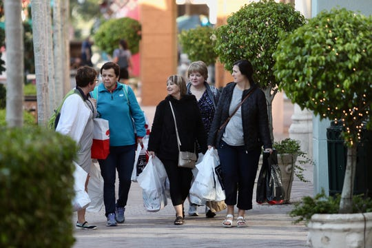 Rosie Boland, left, Terri Roche, Ellen White,  Paula Kieley, and Trudy Smith of Newfoundland, Canada shop at Miromar Outlets on Friday, Nov. 23, 2018. The group of friends comes down to shop on Black Friday every year and have been shopping since 5 p.m. Thursday.