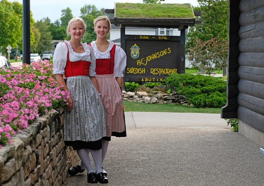 Employees pose outside Al Johnson's Swedish Restaurant & Butik in Sister Bay.