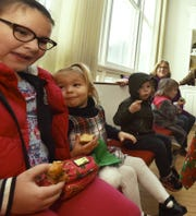 "Vanessa and Gabriella Demarinis, Huck Ferguson, Hollande Skinner and Sarah Paschke, from left, sample Moravian treats at Ephraim Moravian Church's annual ADVENTure celebration last year, held the same day as ""Christmas in the Village."""